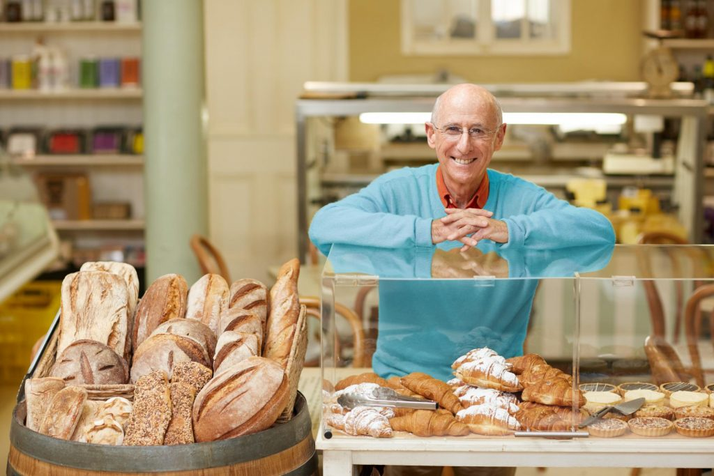 Bakery owner with commercial energy lighting behind him.