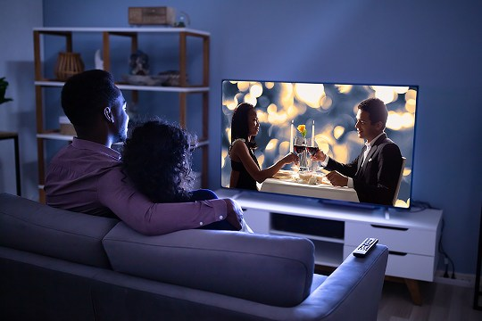 Couple streaming a movie at home.